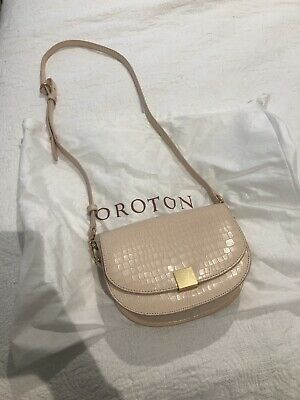 AU25 • Buy OROTON Voyage Texture Mini Saddle Bag Peach