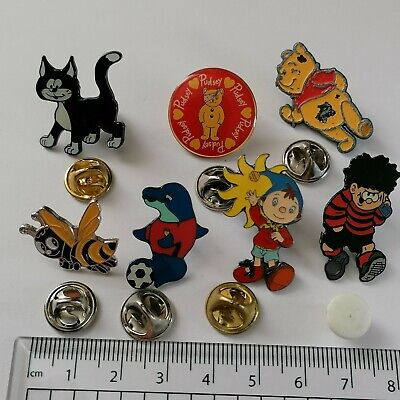 7 Enamel Pin Badges Includes Noddy, Dennis The Menace. • 2.30£