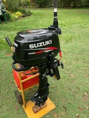 AU1500 • Buy Suzuki 6hp Outboard Motor, Complete With Fuel Tank And Trolley.