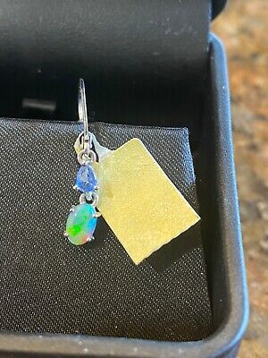 AU600 • Buy 9 Karat Gold Opal Earrings With Saphires In White Gold