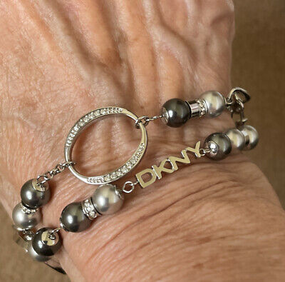 £32 • Buy New Boxed Dkny Silver Colour Linked Bracelet With Grey Pearls And Crystal Hoops.