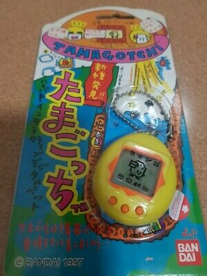 AU145 • Buy ORIGINAL 1997 Bandai Tamagotchi Shinshu Hakken Yellow/Orange