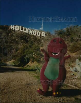 $ CDN42.71 • Buy 1998 Press Photo Barney The Purple Dinosaur Poses In Front Of Hollywood Sign