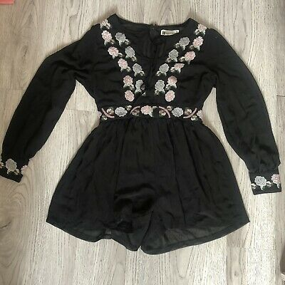 £2 • Buy Hearts And Bows Asos Floral Playsuit. Size 10.