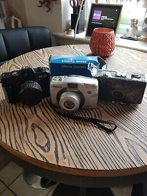 Bundle Of Old Cameras Including A Polaroid • 20£