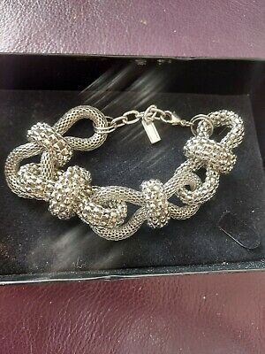 Silver Coloured Chunky Knot Bracelet • 5£