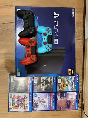 AU500 • Buy NEW PS4 PRO 1TB With TWO Controllers  And 4 Games