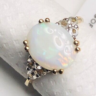 9K Anadamooka Semi Black Opal And White Topaz Yellow Gold Ring.  1.666 Carats • 100£