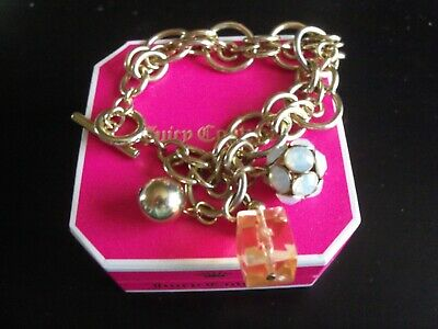Juicy Couture Charm Bracelet • 14£