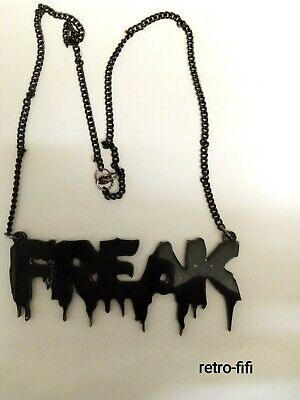 ACRYLIC LASER CUT BLACK GLOSSY FREAK WORD NECKLACE.1.5 X4  & CHAIN IS 25  • 9£