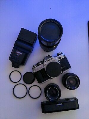 Canon AE1 Bundle With FD 50MM F1.8, 28MM F2.8, 70-210 F4, And Accessories • 200£