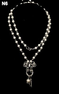 Long Single Strand Drop Necklace With Off White Faux Earls And Silver Tone Bow  • 1.49£