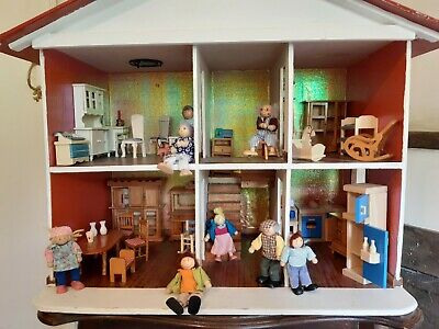 £10 • Buy Wooden Dolls House With Family Characters And Furniture.