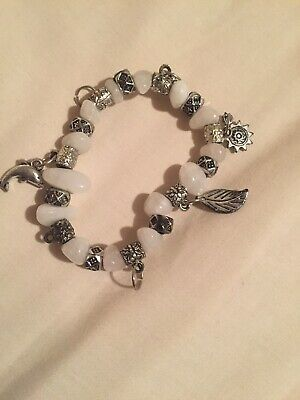 £4.99 • Buy White And Silver Charm Braclet