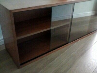 VINTAGE LOW BOOKCASE WITH GLASS DOORS. TEAK. Collection - Wales. • 65£