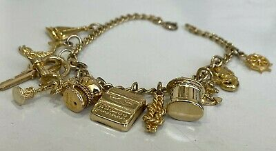 AU1198 • Buy 9ct Solid Gold & Twelve Charm Bracelet 18.42g / 18cm