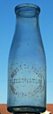 Pint Wide-necked Milk Bottle From RILEY'S DAIRIES, HULL & BRIDLINGTON.   • 3£