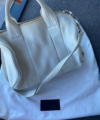 AU200 • Buy Authentic Alexander Wang Rocco Bag White With Rose Gold Studs
