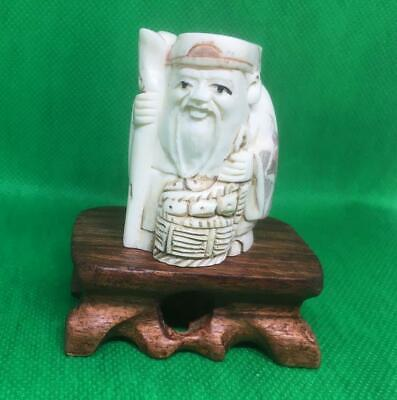 NETSUKE BOVINE (cow) BONE HAND CARVED OLD FRUIT SELLER ON STAND WELL DECORATED • 42£