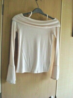 A Soft, Long Sleeved Cream Off The Shoulder Jumper With Flared Cuffs.  River Isl • 2.50£