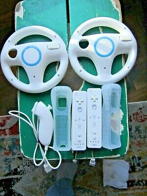 $ CDN44.31 • Buy  Nintendo Wii 2-Remote Controllers W/Covers Straps 1-Nunchuck 2-Steering Wheels
