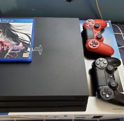 AU270 • Buy PS4 Pro With 2 Controllers And 12 Games