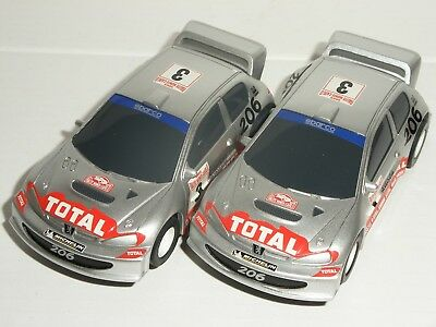 12V MICRO Scalextric - Pair Of Peugeot 206WRC - NEW • 15.99£