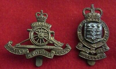 2 X  Military Cap Badges -----  ROYAL ARTILLIERY / ARMY ORDNANCE CORPS • 5.99£