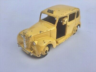VINTAGE DINKY TOYS No. 245 AUSTIN LONDON TAXI IN GOOD CONDITION. • 2.21£