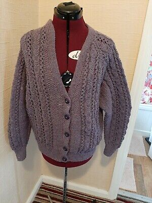 Hand Knitted Cardigan • 25£