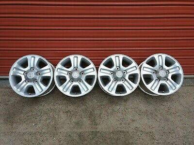 AU795 • Buy 4x GENUINE LANDCRUISER 100 SAHARA ALLOY WHEELS FACTORY 17 X 8 RIMS & LUG NUTS