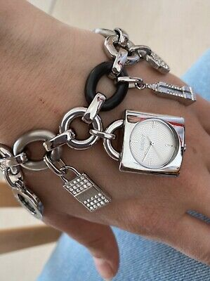 £35 • Buy Dkny Silver Charm Bracelet With Watch Feature.