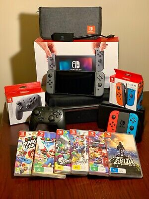 AU525 • Buy NINTENDO SWITCH HAC001 CONSOLE W/ Pro Controller, Extra Joy Cons, And 6 Games