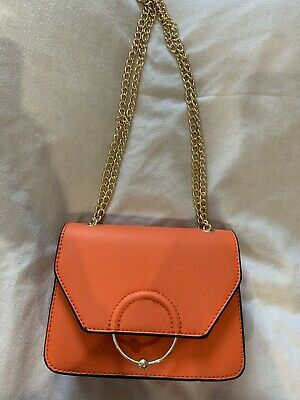 ASOS DESIGN Ring And Ball Cross Body Bag In Orange With Gold Chain Strap • 3£