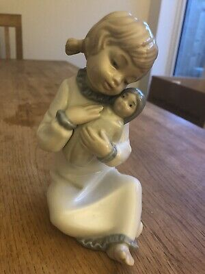 Nao. Girl With Baby. • 5£
