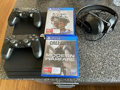 AU222.50 • Buy Ps4 Pro 1tb Black Console , With Wireless Headset, 2 Controllers And 2 Games