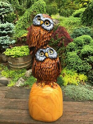 Chainsaw carved owl on books out of yew chainsaw carving wood
