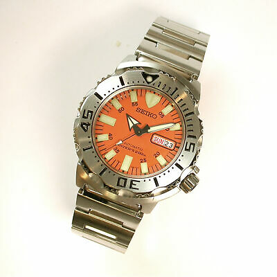 $ CDN493.06 • Buy New $895 MENS 42MM ORANGE DIAL SEIKO MONSTER DIVER AUTOMATIC WATCH #7S26-0350 OR