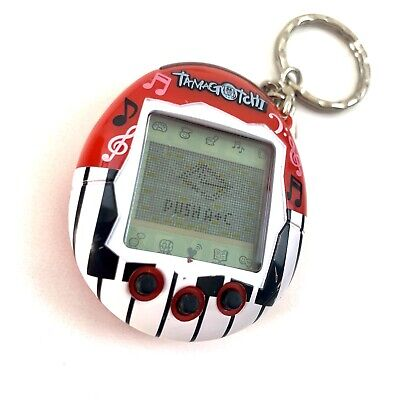 AU74.50 • Buy Tamagotchi Red 2004 Tested And Fully Working *RARE Sent With Tracking Aus Post