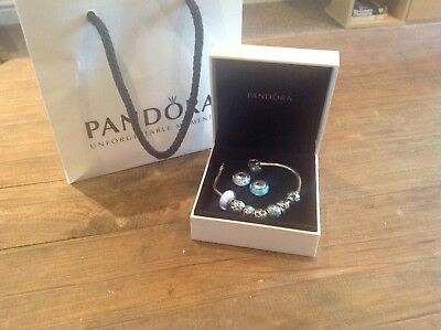 Pandora Braclet With 9 Charms Genuine • 1,000£