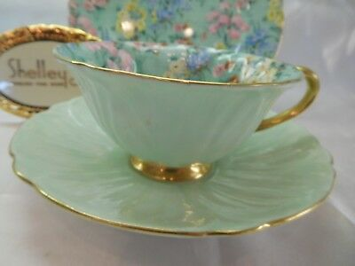 Shelley MELODY CHINTZ  FOOTED OLEANDER  CUP, SAUCER AND 7  PLATE  -  GOLD TRIM   • 188.32£