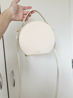 AU86 • Buy Oroton Circle Cream Handbag