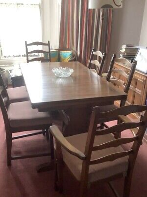 Ercol Golden Dawn Extending Dining Table And 8 Dining Chairs (inc. 2 Carvers) • 48£