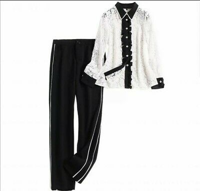 Long Sleeved Lace Top With Black Collar, Cuffs And Black Trousers With Stripes • 49£