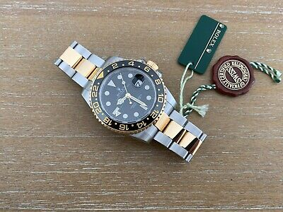 $ CDN18137.20 • Buy Rolex GMT-Master II 18K Gold & Stainles Steel Two-Tone Black Dial Watch 116713LN