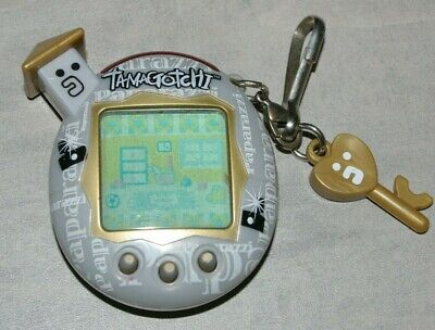 AU139.99 • Buy Bandai Tamagotchi Paparazzi Silver Version 5.5.  2004 Good Working Condition.