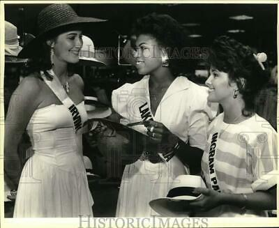 $12.88 • Buy 1985 Press Photo Miss Texas USA Pageant Contestants Try On Hats At Dillards