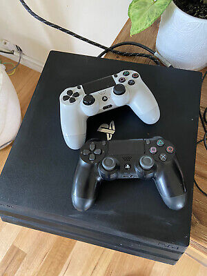AU265 • Buy PS4 Pro With Two Controllers And Dual Charger.