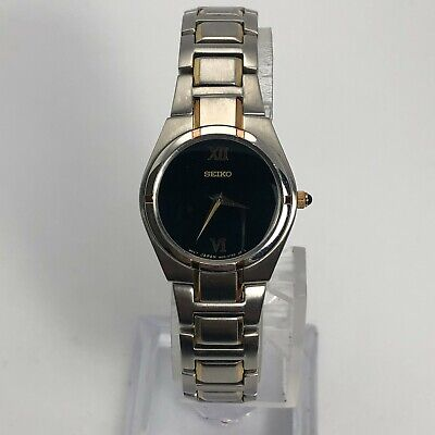 $ CDN45.48 • Buy Seiko Womens 1N00-0LS0 Stainless Steel Black Round Dial Analog Wrist Watch