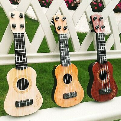 AU10.44 • Buy Children's Toy Gift Ukulele Guitar Musical Instrument Suitable For Baby Kids AUS